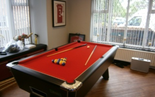 Supreme Winner Pool Table Black Finish with Orange Cloth
